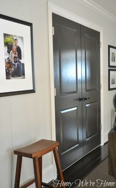 Ever since painting the half-bath door glossy dark gray, I've been wanting to paint the doors in the upstairs hallway the same way.  Painting doors isn't as daunting as you might think, and the impact adds some nice drama to a space.  Here's how the doors looked originally:And below is how they look after two coats of paint- Sherwin Williams Brown Fox in semi-gloss for extra shine.The paint color is a warm dark gray with a hint of brown in it.I painted these doors off the hinges,