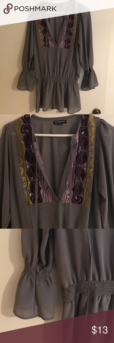 Boho gray/purple blouse Grayish purple low-cut blouse with sequined details around cut. Sinched around waist. Cha Cha Vente Tops Blouses