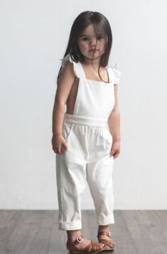 A bib front overall with adjustable ruffled straps in the most stunning ivory linen that softens with every wash. Roll up at the ankles to adjust the length. Cute Baby Girl Outfits, Cute Outfits For Kids, Little Girl Dresses, Girls Dresses, Little Girl Fashion, Toddler Fashion, Fashion Kids, Baby Overalls, White Overalls