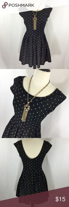 Black and gold polka dot party dress Adorable black and gold metallic polka dot skater party dress from Forever 21 size small. Side zip, scoop back. Polyester and metallic knit. Some pulling but not noticeable with fabric. 30 inches long 16 inches armpit to armpit 24 inch waist Forever 21 Dresses Mini