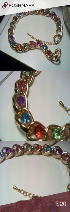 Statement Necklace Beautiful multi coloured gold tone necklace.  Substantial, never worn.  17 inches with 3 inch extender. Thanks for stopping by! Jewelry Necklaces