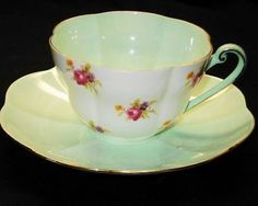 SHELLEY WARWICK ROSE CHINTZ GREEN TEA CUP AND SAUCER