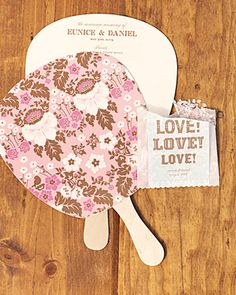 Ceremony programs in a fun paddle shape to cool guests at a summer wedding