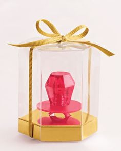 Ring Pop gift idea for guests at a girls party, You can buy the ring pops at Dollar Tree and Also some white wedding favor boxes can be decorated to match the theme. :) DOING THIS!!! Stick some Styrofoam in to hold the ring pops down!