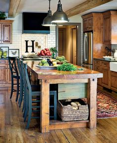 I really like the rustic and a bit primitive looking wood kitchen island. The industrial iron lighting adds a fun eclectic touch to this more Tuscan themed kitchen. Overall, it's a great look.