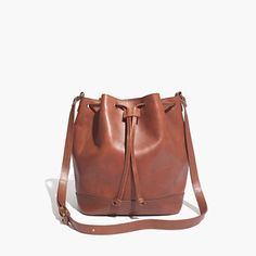 """Streamlined, simple and logo-free, this is a smaller crossbody version of our traditional bucket bag. Still plenty roomy, it's crafted in a wear-it-forever leather that looks better and better the more you break it in. <ul><li>Leather.</li><li>Drawstring closure.</li><li>Interior pocket.</li><li>21 5/8"""" shoulder strap.</li><li>12 13/16""""H x 9 5/8""""W x 5 1/2""""D.</li><li>Import.</li></ul>"""