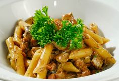Chicken Penne alla toscana with pasta and vegetables in rose wine sauce...