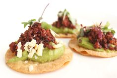 At one of today's weddings, we just dazzled taste buds with crispy, savory Tostaditas de Chorizo appetizers. Served on top of chips made fresh daily, we smother on creamy guacamole and then top it off with smokey traditional chorizo. It was a perfect way to get everyone excited for the main course.  More: https://www.sohotaco.com/2016/02/20/crispy-savory-tostaditas-de-chorizo-appetizers #tacocatering #lafoodies #weddingideas #lawedding