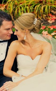 An elegant wedding updo with sparkly fascinator and chandelier earrings (Photo by Calynn Berry)