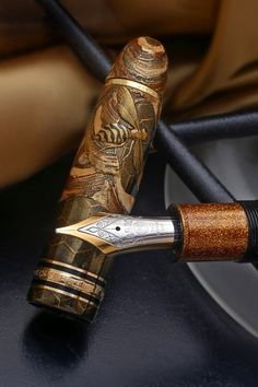 Wondering about a graduation gift for your favorite nephew? A lovely fountain pen is a item he can use for years. Love the bee on this old-fashioned fountain pen.