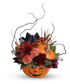"""Halloween Magic Bouquet   What a """"boo""""-tiful way to wish them a Happy Halloween! This spirited mix of lilies, carnations, mums and fun fall accents is hand-delivered in a delightful ceramic pumpkin, the perfect Halloween candy jar! #EllentonFlorist Halloween Flower Arrangements, Halloween Flowers, Halloween Magic, Halloween Candy, Halloween Gifts, Floral Arrangements, Halloween Decorations, Happy Halloween, Halloween Centerpieces"""
