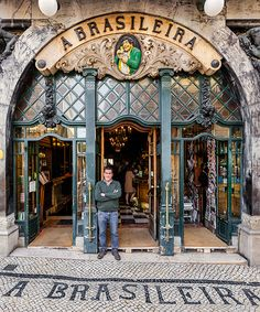 decorative tiles and typography tell the story of lisbon through its storefronts