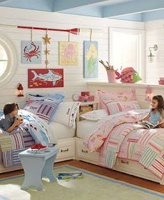 I love how white walls and furniture anchor the decor accessories in this boy and girl shared bedroom. The pink and blue bedding from Pottery Barn Kids works well together. The personalized pillows are a nice touch. For more kids room decorating and organ Boy And Girl Shared Room, Boy Girl Bedroom, Boy Room, Twin Room, Nursery Room, Nursery Decor, Sister Room, Brother Sister, Shared Bedrooms