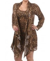 Chic Leopard Dress  One-piece dress. Even when stretched, fabric print remains the same, its not altered, as the cloth is woven with this print.  Fabric: Polyester, Rayon and Spandex mix.  Made in USA.  S$150.00