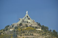 LEBANON, EHDEN, MODERNISTIC CHURCH WITH WILD YELLOW FLOWERS