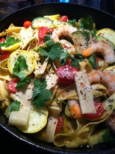 Cherry tomatoes, yellow tomatoes, lemon fettuccine, zucchini, yellow squash, red pepper flakes, shrimp, olive oil, and squeeze lemon juice and topped with cilantro- my personal dinner ( I never measure so.... Try it )