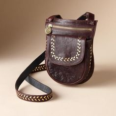 Leather & Brass Sling Bag $298.00 ...too small for me, but would be great for steampunk