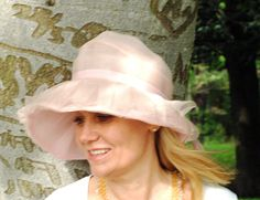 Swedish girl; Therese Enström at Djugården Stockholm. Big pink French hat.