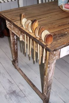 I love this table. How cute are the wooden spoon holes ? (from Chez Fifi)