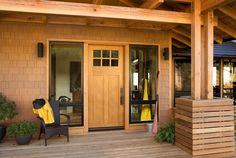 Indistinguishable from real wood, this Fiberglass Craftsman door (Aurora Glass Panel #A362) in Oak woodgrain complements this rustic architecture.