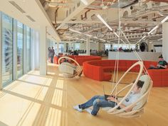 Hanging lounge chairs and big circular booths give staff scope for different work environments - at UKTV by Penson