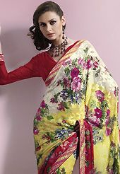 Exquisite combination of color, fabric can be seen here. This off white, yellow and red brasso faux georgette saree is nicely designed with floral print, lace and patch work. Saree gives you a singular and dissimilar look. Matching red blouse is available. Slight color variations are possible due to differing screen and photograph resolution.