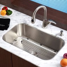 This Kraus kitchen sink is a great centerpiece for any kitchen remodeling project. The sink is constructed from 16-gauge premium grade T-304 stainless steel. Mounting hardware, a stainless steel bottom grid and strainer are included.
