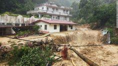 Las lluvias y los deslizamientos de tierra por del tifón Soudelor causaron daños en zonas habitacionales de Xinbei City, Taiwán.