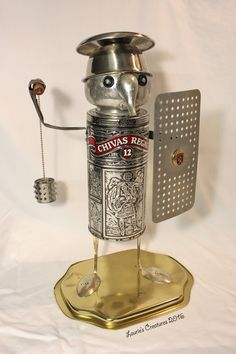 """Sir Chivas"" ~ Found object, junk art created by Laurie Schnurer in 2016. The lid also comes off to store items inside. Maybe even a bottle of Chivas! To purchase one of Laurie's Creatures go to https://www.facebook.com/LauriesCreatures."