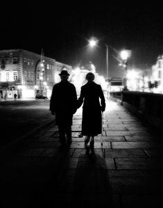 This is a night photography picture of a couple in Cork City, Ireland which is also available as a photography print from my Etsy shop. PRINTED IMAGE SIZE : 5 inches x 7 inches, 8 inches x 10 inches, 11 inches x 14 inches, 16 inches x 20 inches. #mood #atmosphere #art #minimalist #street #photography #black #and #white #prints #cork