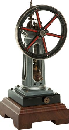 STUART LIVE STEAM SCALE MODEL WILLIAMSON VERTICAL ENGINE  Height of model:11 inches (27.9 cm)  Finely engineered and presented precision scale model of a British Victorian vertical engine. Mounted on wood plinth.