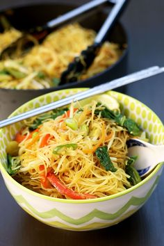 Simple One Pan Singapore Noodles recipe made from rice vermicelli (thin rice noodles), curry powder, bean sprouts, bok choy, spring onion, carrots, red pepper, snow peas, and a ton of other nutritious and easy-to-get ingredients. Vegan, gluten-free, and healthy!