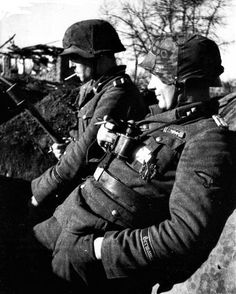 SS-Untersturmführer Paul Barten (foreground) with an SS-Unterscharführer from the Regiment Germania of the Wiking Division in a defensive positions in the spring of During this time, Wiking Division saw fierce combat in the Kovel sector. German Soldiers Ww2, German Army, Germany Ww2, German Uniforms, Military Pictures, Ww2 Pictures, War Photography, Panzer, Luftwaffe