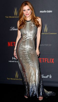 BELLA THORNE goes for serious sparkle in a second-skin sequin sheath gown with mesh chandeliers and glittery Stuart Weitzman sandals at the Weinstein Co. Bella Thorne 2016, Golden Globes 2016, Selena Gomez Style, Bollywood, Beautiful Redhead, Beautiful Women, Beautiful People, Silver Dress, Silver Sequin
