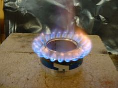 This ingenious little stove made from 2 aluminum cans was designed by Scott Henderson.  I've fed 3 adults for 3 days in the snow on one of these.  So light.  No moving parts.  But...not easy to make.