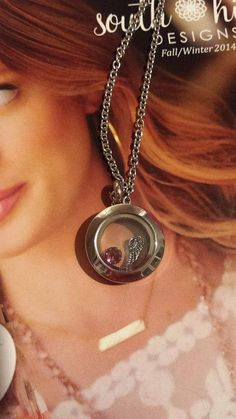 Silver Mini South Hill Design's Locket with Silver Angel wing charm and June Birthstone, vist http://www.southhilldesigns.com/andreabrindley