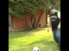 Fat boy falls and fails trying to kick a ball.