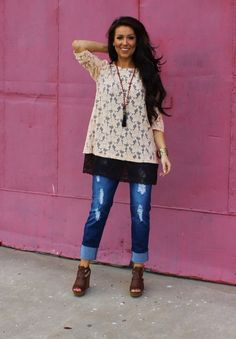 Lightly distressed relaxed fit full length bootcut jeans at The Lace Buckle Boutique – $40 | The Lace Buckle Boutique