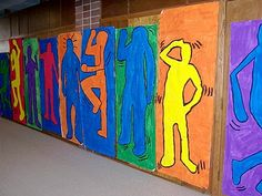 The 7th grader's turned into Pop Artists earlier this semester as we studied Keith Haring! We created a paper mural using Haring's figurative style, bright colors, and use of motion. The student's did a great job tracing, painting, and creating individual posters. The mural was put up in the main Middle School hallway for everyone to see. It was a great way to get the students out of their seats and moving!