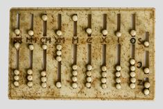 abaque romain  Fabriqué en ivoire, sable, pierre, bois... Instrument pour le calcul