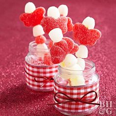 """Nothing says """"Valentine's Day"""" like a sweet treat. Stack assorted gumdrops on a toothpick and stick inside a small mason jar. Decorate the mason jar with your choice of ribbon. These adorable Valentine's Day gifts are perfect for when you're looking to give out multiple valentines because they're easy and require minimal supplies."""