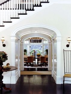 Archway Hall under Stairs toward Dining Room (Dutch Colonial in California by Tommy Chambers Interiors). Dark wood stairs with light walls and white trim. Patio Interior, Home Interior, Interior And Exterior, Interior Design, Studio Interior, Houses Architecture, Architecture Design, Classic Architecture, Sweet Home