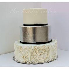 White, silver, wedding cake edible silver leaf, rosette ruffles and velvet bows  www.facebook.com/thehobbycaker