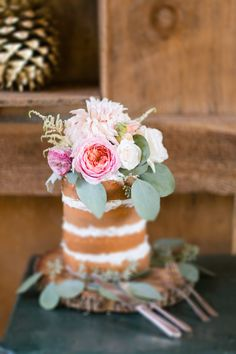 naked cake with floral accents #weddingcake #nakedcake #weddingchicks http://www.weddingchicks.com/2014/01/29/shabby-chic-barn-wedding/