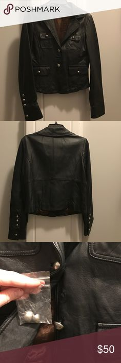 Genuine leather Bebe jacket Soft leather from Bebe and so on trend! Cool detailing. One button recently fell off (see pic) but I have the replacements. bebe Jackets & Coats