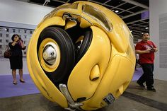 Volkswagen Sphere Volkswagen Sphere Artist Ichwan Noor made this sculpture: yes, it's a real 1953 Volkswagen Beetle, combined with aluminum and polyester, and rolled up into a sphere. It's also an awesome series, which includes cube cars, too. Ichwan Noor via Colossal