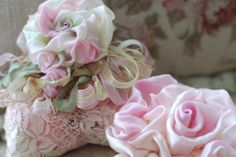 Ribbon roses. I would love to learn how to make these from ribbon. Anyone with tips know how please comment
