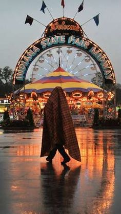Lots of rain and rain and lightning in the afternoon and evening shut down rides at the Midway at the Indiana State Fair in Indianapolis on Thursday, August 16, 2012.