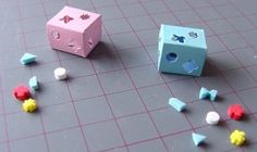 shape sorter - use punches - shinier paper for box (look like plastic) and shapes from foam - brighter colors