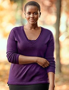 From our Fine Merino collection, this lightweight wool blend sweater is a closet mainstay that spans the seasons. Fine gauge knit layers beautifully, with simple ribbed detailing at V-neck, cuffs and vented hem. lanebryant.com